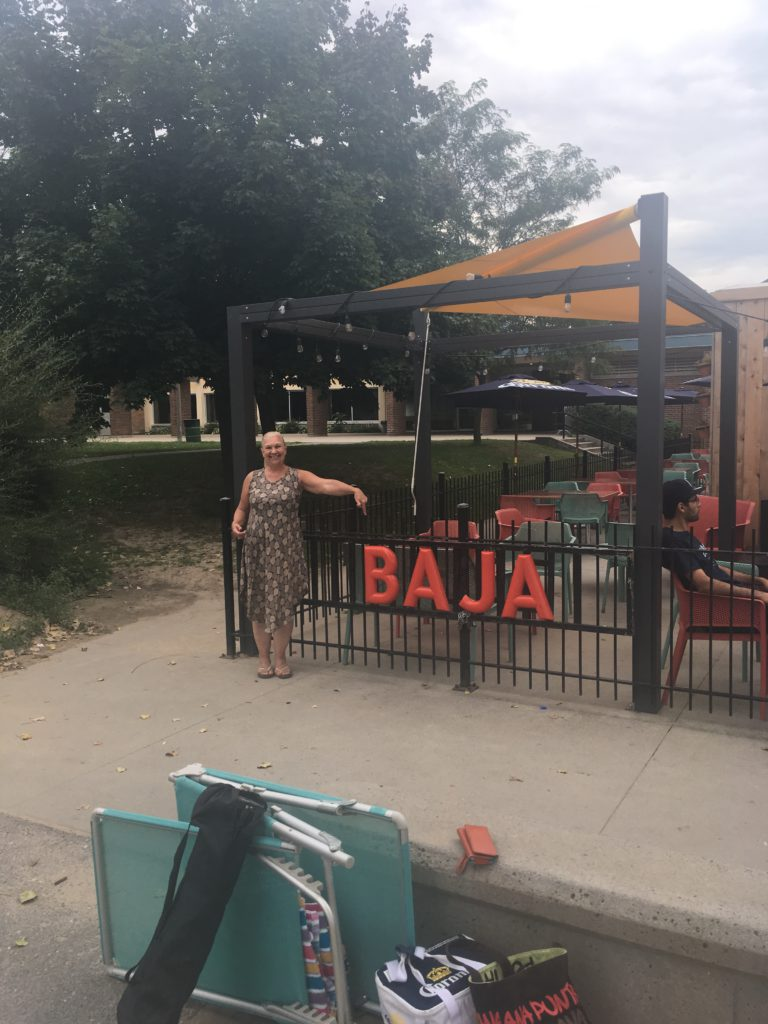 woman standing in front of the Baja Restaurant