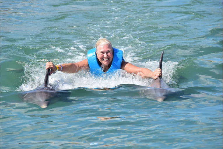 Woman riding dolphin