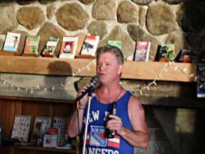 man, performing, mic, beer bottle